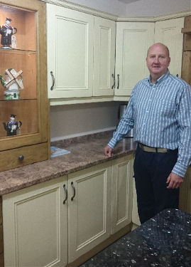 Andrew of New Image standing in front of a show kitchen